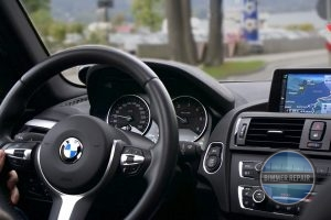 Interior of a BMW, with Focus on Steering Wheel.