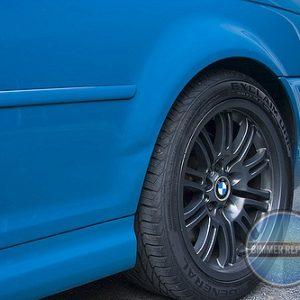 Dented Wheelwell on Blue BMW