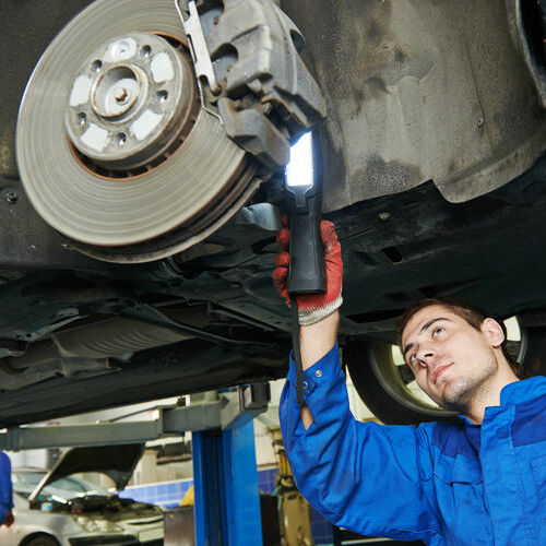 working on brake pad replacement