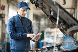 Professional Looking at Pad for Car Repair